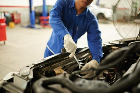 Mechanic working on engine